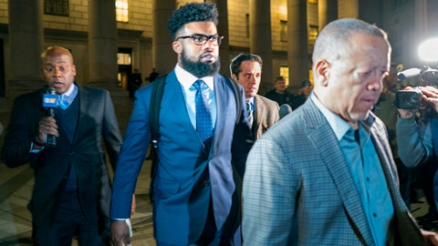 Dallas Cowboys star Ezekiel Elliott, center, exits federal court after a hearing Monday, Oct. 30, 2017 in New York. Elliott is seeking to have his six game suspension by the NFL postponed. (AP Photo/Craig Ruttle)