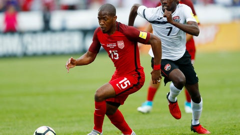 U.S. midfielder Darlington Nagbe, left, pursues the ball with Trinidad & Tobago defender Alvin Jones during the first half of a World Cup soccer qualifying match Thursday, June 8, 2017, in Commerce City, Colo. (AP Photo/David Zalubowski)