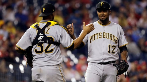 Pittsburgh Pirates relief pitcher Juan Nicasio, right, and catcher Elias Diaz celebrate after the team's baseball game against the Philadelphia Phillies, Thursday, July 6, 2017, in Philadelphia. Pittsburgh won 6-3. (AP Photo/Matt Slocum)