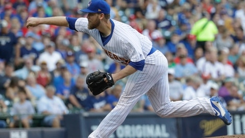 Milwaukee Brewers starting pitcher Jimmy Nelson throws during the first inning of a baseball game against the Philadelphia Phillies Saturday, July 15, 2017, in Milwaukee. (AP Photo/Morry Gash)