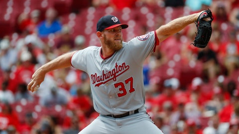 Washington Nationals starting pitcher Stephen Strasburg throws in the first inning of a baseball game against the Cincinnati Reds, Monday, July 17, 2017, in Cincinnati. (AP Photo/John Minchillo)