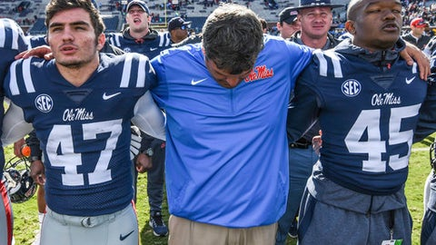 FILE - In this Saturday, Oct. 28, 2017, file photo, Mississippi interim head coach Matt Luke looks down toward the ground following a 38-37 loss to Arkansas in an NCAA college football game at Vaught-Hemingway Stadium in Oxford, Miss.  Ole Miss is another school that's almost certain to make a coaching change. Hugh Freeze resigned before the season after a school investigation into his phone records found personal misconduct. Interim coach Matt Luke hasn't had much success in Freeze's place, with a 3-5 record, including a 1-4 mark in the SEC. (Bruce Newman/The Oxford Eagle via AP, File)/