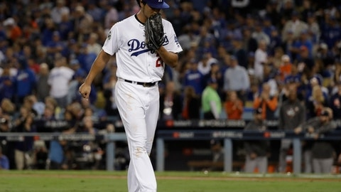Los Angeles Dodgers starting pitcher Yu Darvish reacts after being taken out of the game during the second inning of Game 7 of baseball's World Series against the Houston Astros Wednesday, Nov. 1, 2017, in Los Angeles. (AP Photo/Matt Slocum)