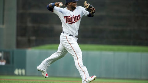 FILE - In this July 17, 2017, file photo, Minnesota Twins third baseman Miguel Sano throws to first after fielding a ball hit by a New York Yankees batter during the first inning of a baseball game in Minneapolis. Sano will have surgery for a persistent leg injury that knocked him out for six weeks during the season. (AP Photo/Bruce Kluckhohn, File)