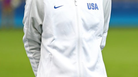 """United States goalkeeper Hope Solo stands as players listen to the national anthems before a women's Olympic football tournament match against New Zealand at the Mineirao stadium in Belo Horizonte, Brazil, Wednesday, Aug. 3, 2016. Solo says she was not bothered by fans who chanted """"Zika, Zika"""" at her as the U.S. women's soccer team defeated New Zealand in its Olympic debut on Wednesday. The crowd jeered the goalkeeper with the reference to the virus that has scared many athletes ahead of the Rio Games.(AP Photo/Eugenio Savio)"""
