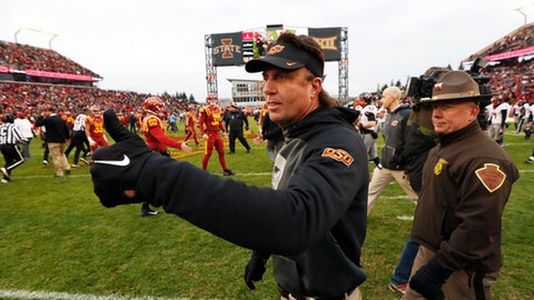 Oklahoma State head coach Mike Gundy reacts as he walks off the field after an NCAA college football game against Iowa State, Saturday, Nov. 11, 2017, in Ames, Iowa. Oklahoma State won 49-42. (AP Photo/Charlie Neibergall)