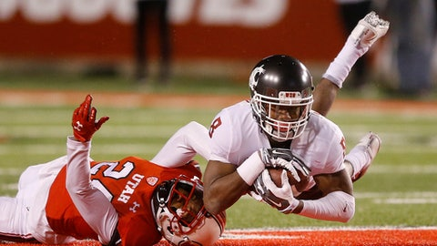 Utah defensive back Kenric Young, left, tackles Washington State wide receiver Tavares Martin Jr. (8) after catching a pass in the second half during an NCAA college football game, Saturday, Nov. 11, 2017, in Salt Lake City. (AP Photo/Rick Bowmer)