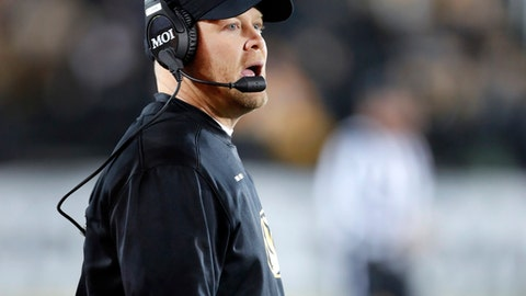 Missouri head coach Barry Odom watches from the sideline during the first half of an NCAA college football game against Tennessee, Saturday, Nov. 11, 2017, in Columbia, Mo. (AP Photo/Jeff Roberson)