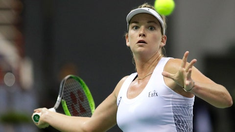 CoCo Vandeweghe of the United States returns a ball to Aryna Sabalenka of Belarus during the Fed Cup final match between Belarus and USA, in Minsk, Belarus, Sunday, Nov.12, 2017. (AP Photo/Sergei Grits)