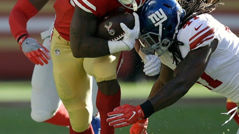 San Francisco 49ers running back Carlos Hyde (28) runs against New York Giants' Kelvin Sheppard, right, cornerback Eli Apple (24) and defensive end Avery Moss (91) during the first half of an NFL football game in Santa Clara, Calif., Sunday, Nov. 12, 2017. (AP Photo/Ben Margot)