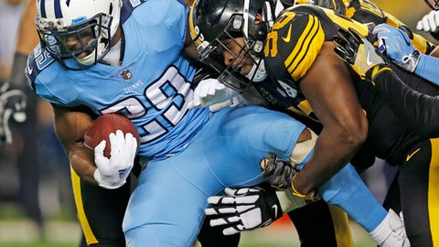 Tennessee Titans running back DeMarco Murray (29) is tackled by Pittsburgh Steelers inside linebacker Vince Williams (98) and others during the first half of an NFL football game in Pittsburgh, Thursday, Nov. 16, 2017. (AP Photo/Keith Srakocic)