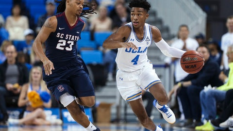 UCLA guard Jaylen Hands, right, dribbles past South Carolina guard Tyvoris Solomon during the first half of an NCAA college basketball game Friday, Nov. 17, 2017, in Los Angeles. (AP Photo/Ringo H.W. Chiu)