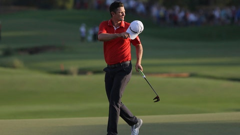 Justin Rose from England reacts to the crowd on the 18th hole during the third round of the DP World Tour Championship golf tournament in Dubai, United Arab Emirates, Saturday, Nov. 18, 2017. (AP Photo/Kamran Jebreili)