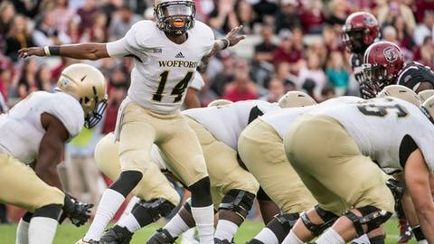 Wofford quarterback Brandon Goodson (14) communicates with teammates during the first half of an NCAA college football game against South Carolina on Saturday, Nov. 18, 2017 in Columbia, S.C. South Carolina defeated Wofford 31-10. (AP Photo/Sean Rayford)