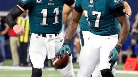 Philadelphia Eagles' Carson Wentz (11) celebrates after throwing a touchdown pass to Alshon Jeffery (17) in the second half of an NFL football game against the Dallas Cowboys on Sunday, Nov. 19, 2017, in Arlington, Texas. (AP Photo/Michael Ainsworth)