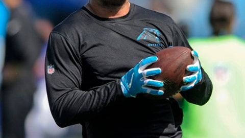 FILE - In this Sept. 17, 2017, file photo, Carolina Panthers tight end Greg Olsen warms up before the start of an NFL football game against the Buffalo Bills in Charlotte, N.C. Panthers tight end Greg Olsen practiced on Monday, Nov. 20, 2017, for the Panthers and is eligible to return to the 53-man roster this week after missing eight weeks on injured reserve with a broken foot. (AP Photo/Mike McCarn, File)