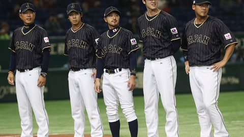 FILE- THIS Nov. 11, 2016, file photo shows Team Japan, from left, manager Hiroki Kokubo, infielder Tetsuto Yamada, infielder Ryosuke Kikuchi and designated hitter Shohei Ohtani and infielder Sho Nakata standing during a ceremony prior to their international exhibition series baseball game against Mexico at Tokyo Dome in Tokyo. A person familiar with the agreement tells The Associated Press that Major League Baseball, its Japanese counterpart and the American players' union agreed Tuesday, Nov. 21, 2017,  to a new posting system that could allow Japanese star pitcher-outfielder Shohei Ohtani to be put up for bid next week.  (AP Photo/Koji Sasahara, File)