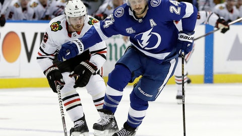 Tampa Bay Lightning right wing Ryan Callahan (24) gets around Chicago Blackhawks defenseman Duncan Keith (2) during the second period of an NHL hockey game Wednesday, Nov. 22, 2017, in Tampa, Fla. (AP Photo/Chris O'Meara)