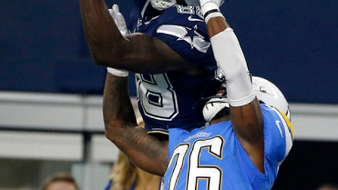 Los Angeles Chargers cornerback Casey Hayward (26) breaks up a pass in the end zone intended for Dallas Cowboys' Dez Bryant, top, in the second half of an NFL football game, Thursday, Nov. 23, 2017, in Arlington, Texas. (AP Photo/Ron Jenkins)