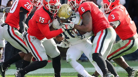 Georgia defenders J.R. Reed, from left, D'Andre Walker, Natrez Patrick and Roquan Smith swarm Georgia Tech quarterback TaQuon Marshall in the second half of an NCAA college football game Saturday, Nov. 25, 2017, in Atlanta. Georgia won, 38-7. (Curtis Compton/Atlanta Journal-Constitution via AP)