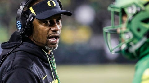 Oregon head coach Willie Taggart gives feedback from the sidelines against Oregon State in an NCAA college football game Saturday, Nov. 25, 2017 in Eugene, Ore. (AP Photo/Thomas Boyd)