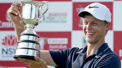 Australia's Cameron Smith smiles after being presented his trophy after winning the Australian Open Golf tournament in Sydney, Sunday, Nov. 26, 2017. (AP Photo/Rick Rycroft)
