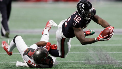 Tampa Bay Buccaneers defensive back Robert McClain (36) tackles Atlanta Falcons wide receiver Mohamed Sanu (12) during the first half of an NFL football game, Sunday, Nov. 26, 2017, in Atlanta. (AP Photo/Chris O'Meara)