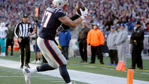 New England Patriots tight end Rob Gronkowski (87) catches a touchdown pass against the Miami Dolphins during the second half of an NFL football game, Sunday, Nov. 26, 2017, in Foxborough, Mass. (AP Photo/Steven Senne)