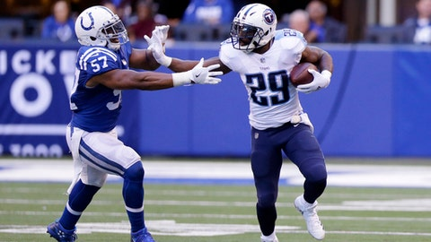 Tennessee Titans' DeMarco Murray (29) runs against Indianapolis Colts' Jon Bostic (57) during the second half of an NFL football game, Sunday, Nov. 26, 2017, in Indianapolis. Tennessee won 20-16. (AP Photo/Michael Conroy)