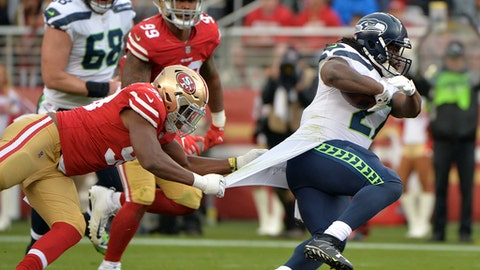 Seattle Seahawks running back Eddie Lacy, right, has his jersey pulled by San Francisco 49ers defensive end Ronald Blair during the first half of an NFL football game Sunday, Nov. 26, 2017, in Santa Clara, Calif. (AP Photo/Don Feria)