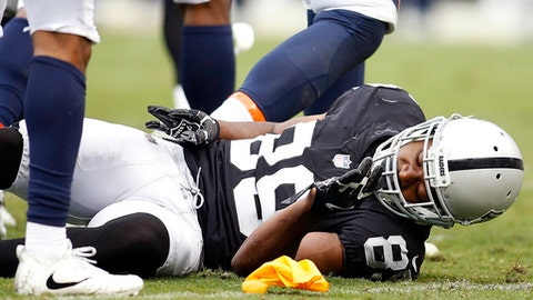 Oakland Raiders wide receiver Amari Cooper (89) remains on the ground after a hit by the Denver Broncos during the first half of an NFL football game in Oakland, Calif., Sunday, Nov. 26, 2017. (AP Photo/D. Ross Cameron)