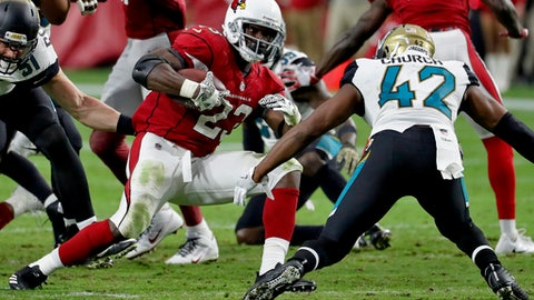Arizona Cardinals running back Adrian Peterson (23) tries to avoid Jacksonville Jaguars strong safety Barry Church (42) during the second half of an NFL football game, Sunday, Nov. 26, 2017, in Glendale, Ariz. (AP Photo/Rick Scuteri)