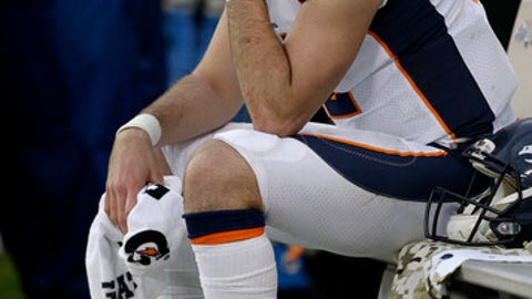 Denver Broncos quarterback Paxton Lynch (12) sits on the bench during the second half of an NFL football game against the Oakland Raiders in Oakland, Calif., Sunday, Nov. 26, 2017. (AP Photo/Ben Margot)