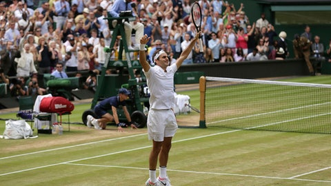 2017 AP YEAR END PHOTOS - Switzerland's Roger Federer celebrates after defeating Croatia's Marin Cilic to win the Men's Singles final match on day thirteen at the Wimbledon Tennis Championships in London on July 16, 2017. (AP Photo/Tim Ireland)