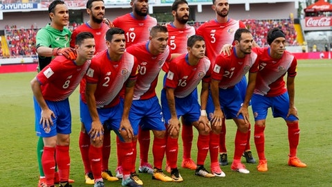 File - In this Saturday, Oct 7, 2017 filer The Costa Rica national soccer team poses for a photo prior a World Cup qualifying soccer match against Honduras, at the National Stadium in San Jose, Costa Rica. (AP Photo/Moises Castillo, File)
