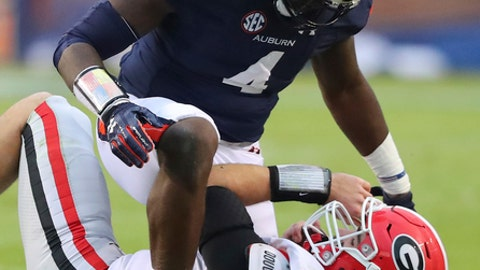 FILE - In this Nov. 11, 2017, file photo, Auburn linebacker Jeff Holand tackles Georgia quarterback Jake Fromm, breaking up a play during the first half of an NCAA college football game, in Auburn, Ala. Three weeks after an ugly loss at Auburn, No. 6 Georgia has perhaps the biggest do-over in school history. At stake will be the Southeastern Conference championship and a probable spot in the College Football Playoff. (Curtis Compton/Atlanta Journal-Constitution via AP, File)