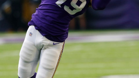 FILE - In this Nov. 19, 2017, file photo, Minnesota Vikings wide receiver Adam Thielen catches a pass during the second half of an NFL football game against the Los Angeles Rams, in Minneapolis. Atlanta is showing signs of finding its 2016 form, and will be severely tested by Minnesota's marvelous defense.  Watch for how Falcons star receiver Julio Jones and Vikings under-the-radar pass catcher Adam Thielen perform. Both are on fire.(AP Photo/Jim Mone)