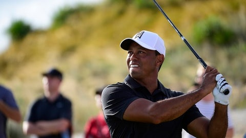 Tiger Woods tees off from hole 16 during the Hero World Challenge golf tournament at Albany Golf Club in Nassau, Bahamas, Thursday, Nov. 30, 2017. (AP Photo/Dante Carrer)
