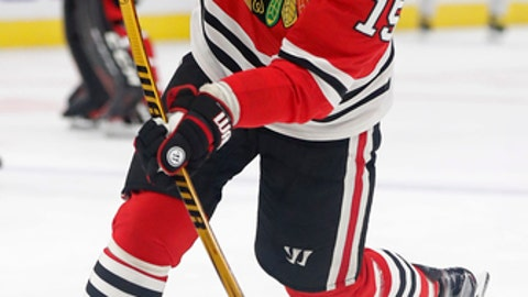 Chicago Blackhawks' Artem Anisimov warms up before an NHL hockey game against the Dallas Stars on Thursday, Nov. 30, 2017, in Chicago. (AP Photo/Jim Young)