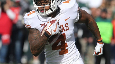 In this Saturday, Oct. 28, 2017 file photo, Texas safety DeShon Elliott returns an interception for a touchdown against Baylor in the first half of an NCAA college football game in Waco, Texas. Texas is headed to its first bowl game since the 2014 season, yet some of the Longhorns' top players aren't sticking around to see what that's like. Junior safety DeShon Elliott on Thursday, Nov. 30, 2017 announced he'll enter the draft and skip the bowl game. The Thorpe Award finalist's decision came after top junior offensive junior Connor Williams opted to do the same. (AP Photo/Rod Aydelotte, File)