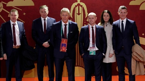 Iceland's delegation pose for the photographers before the 2018 soccer World Cup draw in the Kremlin in Moscow, Friday, Dec. 1, 2017. (AP Photo/Dmitri Lovetsky)