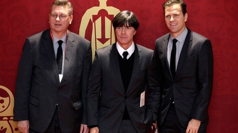 Germany national soccer coach Joachim Loew, center, the head of the German football federation Reinhard Grindel, left, and team manager Oliver Bierhoff pose for the photographers before the 2018 soccer World Cup draw in the Kremlin in Moscow, Friday, Dec. 1, 2017. (AP Photo/Dmitri Lovetsky)