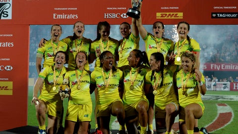 Australia's players celebrate 0-34 victory over the United States in the final of the World Rugby Women's Sevens Series in Dubai, the United Arab Emirates, Friday, Dec. 1, 2017 (AP Photo/Martin Dokoupil)