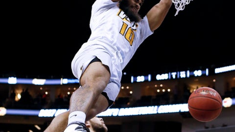 FILE - In this Saturday, March 11, 2017, file photo, VCU's Jonathan Williams dunks after getting by Richmond's Nick Sherod (5) during the first half of an NCAA college basketball game in the Atlantic 10 tournament semifinals in Pittsburgh. Blessed with a lightning-quick first step, the strength and agility of a running back and the ability to shoot with both hands from in close, Williams has spent the past two seasons using penetration to produce points for the Rams. (AP Photo/Keith Srakocic, File)