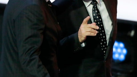 FIFA president Gianni Infantino, left, and Russian President Vladimir Putin leave the stage at the 2018 soccer World Cup draw in the Kremlin in Moscow, Friday, Dec. 1, 2017. (AP Photo/Ivan Sekretarev)