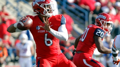 FILE - In this Saturday, Nov. 25, 2017, file photo, Fresno State's quarterback Marcus McMaryion drops back to pass against Boise State during the first half of an NCAA college football game in Fresno, Calif. For the second straight week Boise State and No. 25 Fresno State meet. This time it's for the Mountain West Conference championship and the game is in Boise rather than Fresno. (AP Photo/Gary Kazanjian, File)