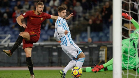 Roma's Edin Dzeko, left, scores his side's first goal during an Italian Serie A soccer match between AS Roma and Spal, at the Olympic stadium in Rome, Friday, Dec. 1st, 2017. (AP Photo/Gregorio Borgia)