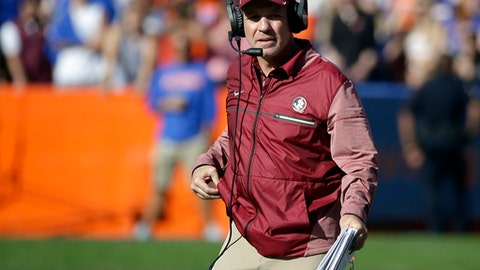 FILE - In this Nov. 25, 2017, file photo, Florida State head coach Jimbo Fisher watches during the second half of an NCAA college football game against Florida in Gainesville, Fla. Two people with direct knowledge of the decision say Fisher has resigned to take the same job at Texas A&M. Fisher handed in his resignation after a meeting with university President John Thrasher on Friday, Dec. 1, 2017. according to the people who spoke on condition of anonymity because Florida State had not announced the move. (AP Photo/John Raoux, File)