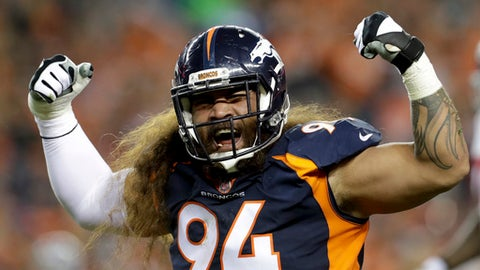 FILE - In this Oct. 15, 2017, file photo, Denver Broncos nose tackle Domata Peko reacts during the first half of an NFL football game against the New York Giants in Denver. Peko will miss his first game since 2009. The 12th-year pro was ruled of Denver's game against the Miami Dolphins because of a sprained MCL in his left knee. (AP Photo/Joe Mahoney, File)