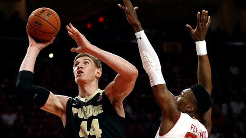 Purdue center Isaac Haas, left, shoots over Maryland forward Bruno Fernando, of Angola, in the first half of an NCAA college basketball game in College Park, Md., Friday, Dec. 1, 2017. (AP Photo/Patrick Semansky)
